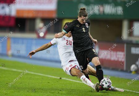 Yussuf Poulsen of Denmark and Marcel Sabitzer of Austria during Austria and Denmark on Ernst-Happel-Stadion stadium, Vienna, Austria