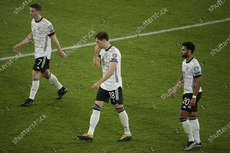 (L-R) Germany's Robin Gosens, Leon Goretzka and Serge Gnabry react during the FIFA World Cup 2022 qualifying soccer match between Germany and North Macedonia in Duisburg, Germany, 31 March 2021.