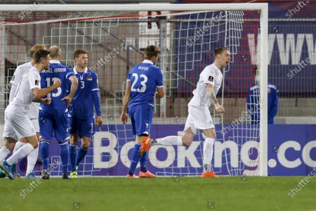 Iceland's Birkir Saevarsson (R) celebrates after scoring the 1-0 lead during the FIFA World Cup 2022 qualifying group J soccer match between Liechtenstein and Iceland in Vaduz, Liechtenstein, 31 March 2021.