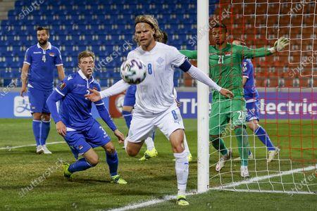 Iceland's Birkir Bjarnason (C) in action during the FIFA World Cup 2022 qualifying group J soccer match between Liechtenstein and Iceland in Vaduz, Liechtenstein, 31 March 2021.