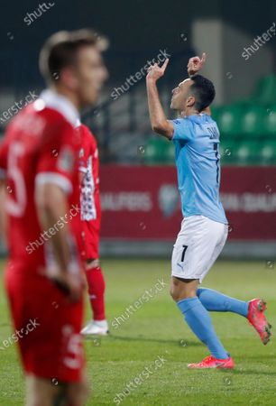Israel's player Eran Zahavi (R) reacts after scoring a goal during the FIFA World Cup 2022 qualifiers match between Moldova and Israel at Zimbru stadium in Chisinau, Moldova, 31 March 2021.