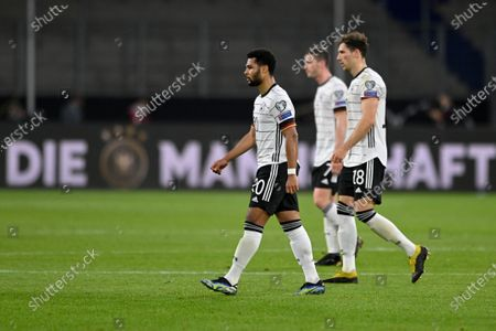 (L-R) Germany's Serge Gnabry, Germany's Robin Gosens and Germany's Leon Goretzka leave the field in the half time break during the FIFA World Cup 2022 qualifying soccer match between Germany and North Macedonia in Duisburg, Germany, 31 March 2021.