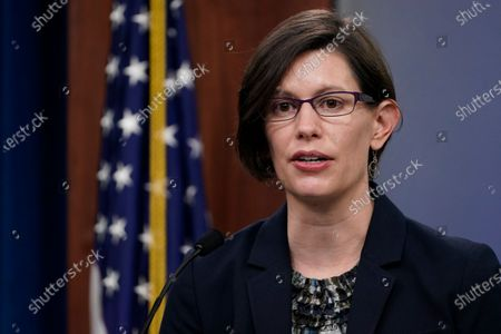 Stephanie Miller, director of ascension policy at the Pentagon, left, speaks during a briefing at the Pentagon in Washington, . It was announced during the briefing that the Pentagon will sweep away Trump-era policies that largely banned transgender people from serving in the military and will issue new rules that broaden their access to medical care and gender transition