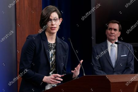 Stock Image of Stephanie Miller, director of ascension policy at the Pentagon, left, standing with Pentagon spokesman John Kirby, right, speaks during a briefing at the Pentagon in Washington, . It was announced during the briefing that the Pentagon will sweep away Trump-era policies that largely banned transgender people from serving in the military and will issue new rules that broaden their access to medical care and gender transition