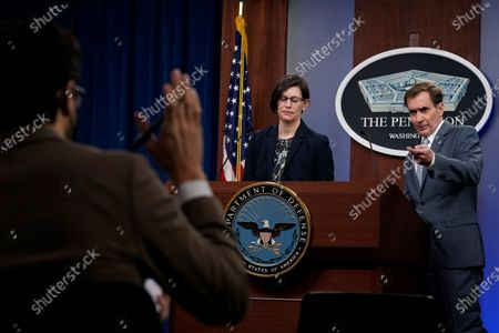 Stephanie Miller, director of ascension policy at the Pentagon, center, and Pentagon spokesman John Kirby, right, speak during a briefing at the Pentagon in Washington, . It was announced during the briefing that the Pentagon will sweep away Trump-era policies that largely banned transgender people from serving in the military and will issue new rules that broaden their access to medical care and gender transition