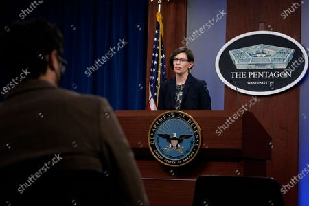 Stock Photo of Stephanie Miller, director of ascension policy at the Pentagon, left, speaks during a briefing at the Pentagon in Washington, . It was announced during the briefing that the Pentagon will sweep away Trump-era policies that largely banned transgender people from serving in the military and will issue new rules that broaden their access to medical care and gender transition