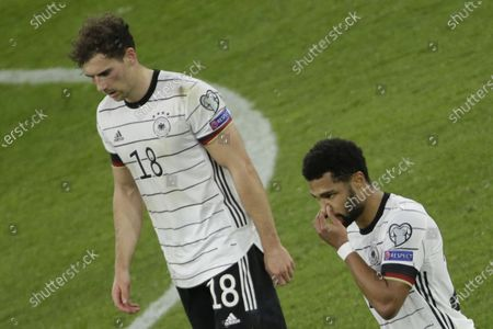 (L-R) Germany's Leon Goretzka and Serge Gnabry react during the FIFA World Cup 2022 qualifying soccer match between Germany and North Macedonia in Duisburg, Germany, 31 March 2021.