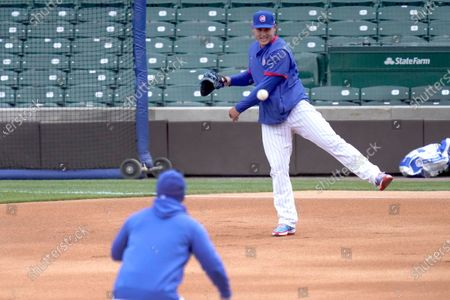 Chicago Cubs first baseman Anthony Rizzo throws to Manager David Ross at second, during the team's last baseball workout, before the home opener Thursday, April 1, 2021, against the Pittsburgh Pirates in Chicago
