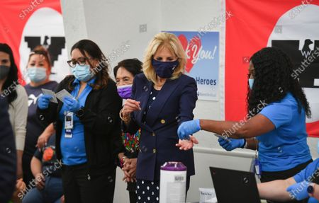 Stock Picture of Labor leader and civil rights activist Dolores Huerta stands next to first lady Jill Biden as she talks with volunteers at a vaccination site at The Forty Acres, the first headquarters of the United Farm Workers labor union, in Delano, Calif