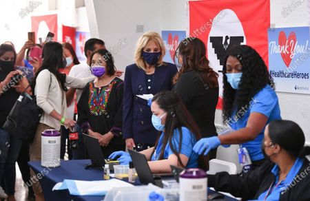 Labor leader and civil rights activist Dolores Huerta stands next to first lady Jill Biden as she talks with volunteers at a vaccination site at The Forty Acres, the first headquarters of the United Farm Workers labor union, in Delano, Calif