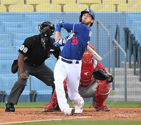 LOS ANGELES CALIFORNIA MARCH 30, 2021-Dodgers Cody Bellinger its a two-run home run against the Angels in the 1st inning during the Freeway Series at Dodger Stadium Tuesday. (Wally Skalij/Los Angeles Times)