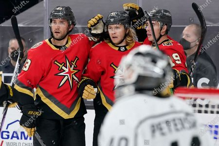 Vegas Golden Knights center William Karlsson, center, celebrates after scoring against the Los Angeles Kings during the second period of an NHL hockey game, in Las Vegas