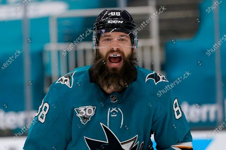 San Jose Sharks defenseman Brent Burns yells toward teammates during the second period of an NHL hockey game against the Minnesota Wild in San Jose, Calif