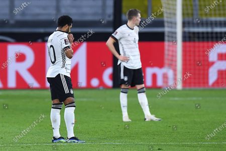Stock Image of Serge Gnabry ( Germany ), front - Matthias Ginter ( Germany ), behind - disappointed after the match to 1:2