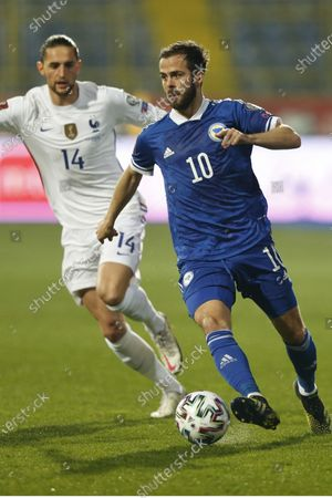 France player Adrien Rabiot challenge for ball with Bosnian Miralem Panic