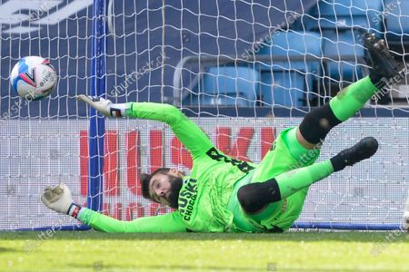 Bartosz Bialkowski of Millwall saves Michael Smith of Rotherham United penalty during the Sky Bet Championship, Championship match between Millwall and Rotherham United at The Den in London - 2nd April 2021