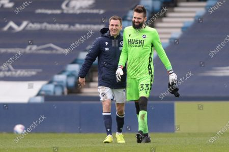 (L-R) Jed Wallace and Bartosz Bialkowski of Millwall celebrate after the Sky Bet Championship, Championship match between Millwall and Rotherham United at The Den in London - 2nd April 2021