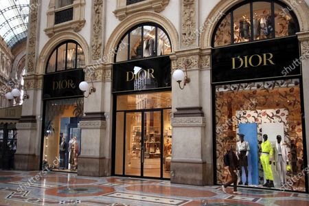 Stock Image of The windows of the new shop of French brand Dior at Galleria Vittorio Emanuele are prepared for the opening in Milan, Italy, 01 April 2021. The maison is designed by Maria Grazia Chiuri and Kim Jones.