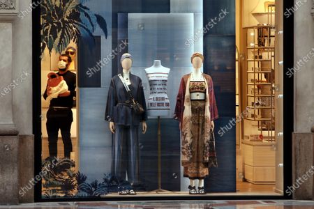 Stock Photo of The windows of the new shop of French brand Dior at Galleria Vittorio Emanuele are prepared for the opening in Milan, Italy, 01 April 2021. The maison is designed by Maria Grazia Chiuri and Kim Jones.