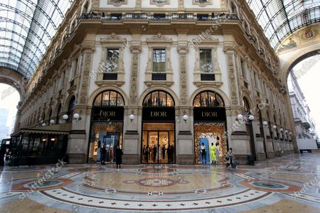 The windows of the new shop of French brand Dior at Galleria Vittorio Emanuele are prepared for the opening in Milan, Italy, 01 April 2021. The maison is designed by Maria Grazia Chiuri and Kim Jones.