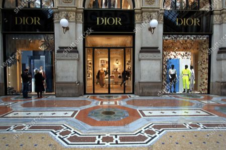 Stock Picture of The windows of the new shop of French brand Dior at Galleria Vittorio Emanuele are prepared for the opening in Milan, Italy, 01 April 2021. The maison is designed by Maria Grazia Chiuri and Kim Jones.