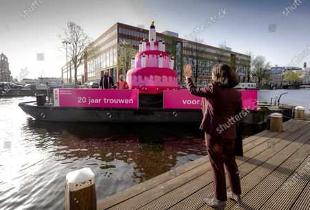 Mayor Femke Halsema of Amsterdam waves at an anniversary boat, during the 'celebration of 20 years of marriage for everyone' in Amsterdam, the Netherlands, 01 April 2021.  Exactly 20 years ago, The Netherlands was the first country in the world to legalize same sex marriage.
