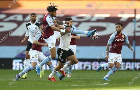 Aleksandar Mitrovic of Fulham  battles with Tyrone Mings of Aston Villa