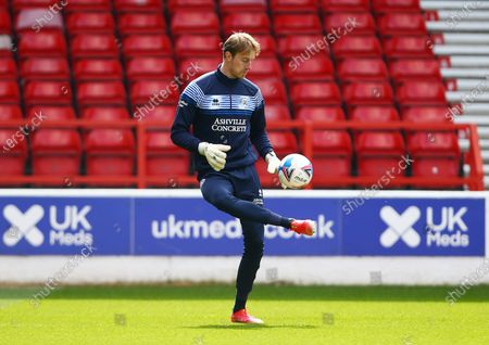 QPR goalkeeper Joe Lumley warms up ahead of the game