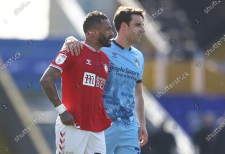 Former Leicester City team mates Danny Simpson of Bristol City and Matthew James of Coventry City embrace at full time