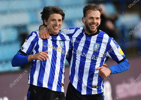 Adam Reach of Sheffield Wednesday (left) celebrates with Jordan Rhodes after scoring his side's fifth goal