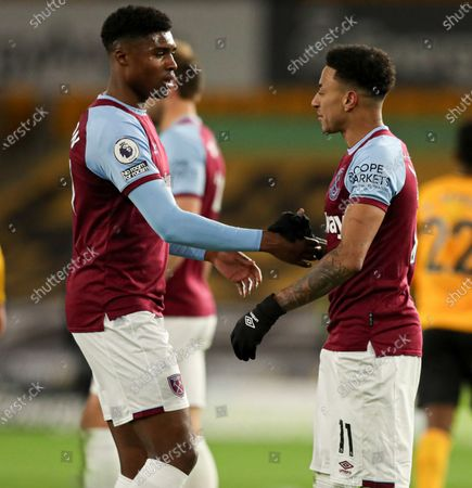 Ben Johnson of West Ham and Jesse Lingard celebrate at full time