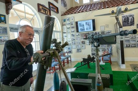 Oscar Rodriguez, member of the Brigade 2506, observes some of the 1961 invasion to Cuba weapons replicas showed at the Museum of the Assault Brigade 2506 in Hialeah Garden, Florida, USA, 25 March 2021. The Bay of Pigs Invasion in April 1961 was a failed attack launched by the CIA during the Kennedy administration to topple Cuban leader Fidel Castro. The Brigade 2506 was formed in 1960, by Cuban exiles, to attempt military incursion to Cuba.