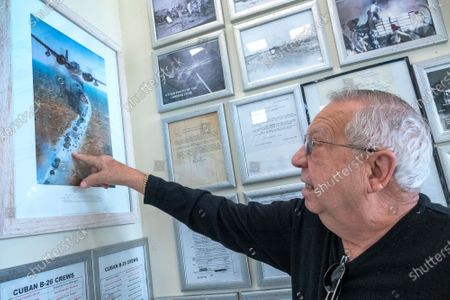 Oscar Rodriguez, member of the Brigade 2506, shows a photo recreation of a scene of the 1961 invasion to Cuba showed at the Museum of the Assault Brigade 2506 in Hialeah Garden, Florida, USA, 25 March 2021. The Bay of Pigs Invasion in April 1961 was a failed attack launched by the CIA during the Kennedy administration to topple Cuban leader Fidel Castro. The Brigade 2506 was formed in 1960, by Cuban exiles, to attempt military incursion to Cuba.