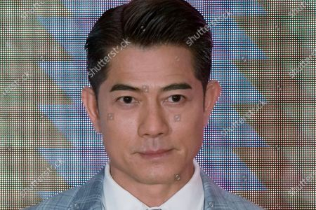 "Stock Image of Hong Kong actor Aaron kwok, who stars in""Where the Wind Blows"", poses for photographers during the 45th Hong Kong International Film Festival, in Hong Kong"