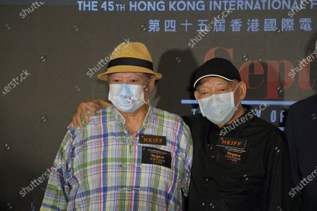 """Joining Hong Kong directors Yuen Woo-ping, right, and Sammo Hung, attend the movie premiere for their movie """"Septet: The Story of Hong Kong"""" during the 45th Hong Kong International Film Festival, in Hong Kong"""