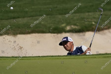 Rickie Fowler plays a shot from a bunker on the seventh hole during the first round of the Texas Open golf tournament, in San Antonio