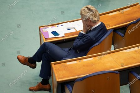 Populist Dutch anti-immigration lawmaker Geert Wilders reacts during a debate in parliament in The Hague, Netherlands, . Caretaker Dutch Prime Minister Mark Rutte was fighting for his political life Thursday in a bitter parliamentary debate about the country's derailed process of forming a new ruling coalition following elections last month