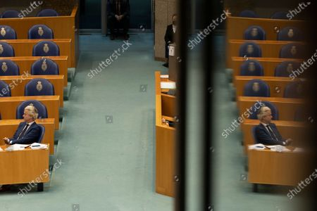 Populist Dutch anti-immigration lawmaker Geert Wilders listens during a debate in parliament in The Hague, Netherlands, . Caretaker Dutch Prime Minister Mark Rutte was fighting for his political life Thursday in a bitter parliamentary debate about the country's derailed process of forming a new ruling coalition following elections last month