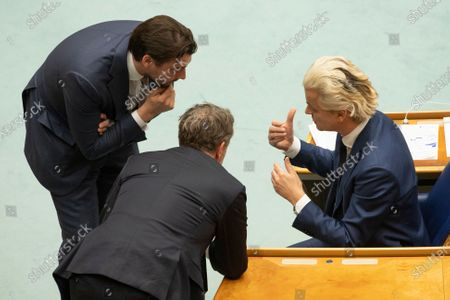 Populist Dutch anti-immigration lawmaker Geert Wilders, right, Thierry Baudet, leader of right-wing populist party Forum for Democracy, left, and fellow party member Wybren van Haga, center, talk during a debate in parliament in The Hague, Netherlands, early . Caretaker Dutch Prime Minister Mark Rutte was fighting for his political life in a bitter parliamentary debate about the country's derailed process of forming a new ruling coalition following elections last month