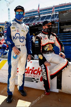 Drivers Ricky Stenhouse Jr., left, and Austin Dillon wait for the start of a NASCAR Cup Series auto race, in Bristol, Tenn