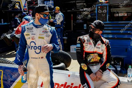 Drivers Ricky Stenhouse Jr., left, and Austin Dillon talk as they wait for the start of a NASCAR Cup Series auto race, in Bristol, Tenn