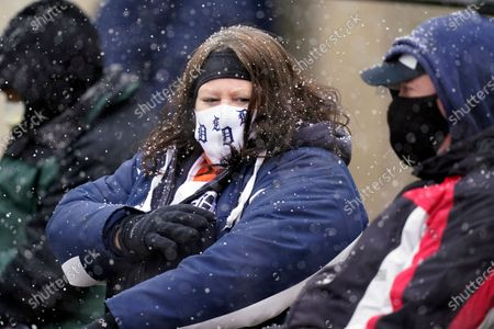 Stock Photo of Patty and Steve Smith watch the baseball game between the Detroit Tigers and the Cleveland Indians as snow falls, in Detroit