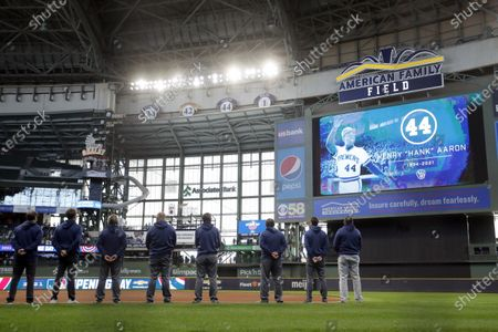 Stock Picture of Milwaukee Brewers' players and staff watch a tribute honoring Hank Aaron before an opening day baseball game against the Minnesota Twins, in Milwaukee