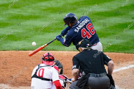 Atlanta Braves' Pablo Sandoval (48) hits a two-run home run off Philadelphia Phillies starting pitcher Aaron Nola during the seventh inning of an opening day baseball game, in Philadelphia