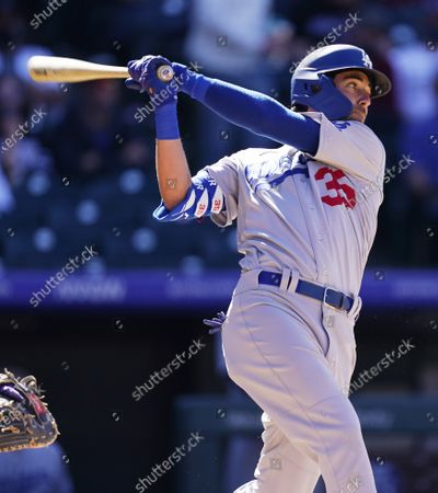 Los Angeles Dodgers' Cody Bellinger watches his double off Colorado Rockies relief pitcher Chi Chi Gonzalez during the fifth inning of a baseball game, in Denver