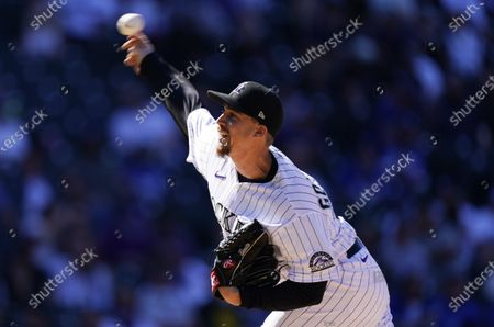 Colorado Rockies relief pitcher Chi Chi Gonzalez works against Los Angeles Dodgers' Cody Bellinger in the fifth inning of a baseball game, in Denver