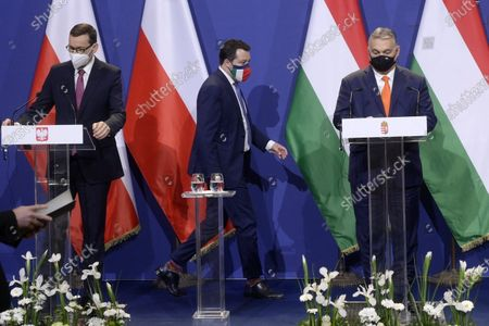 Leader of Italian right-wing ruling party Lega, Matteo Salvini (C) arrives for a joint press conference with Hungarian Prime Minister Viktor Orban (R) and Polish Prime Minister Mateusz Morawiecki (L) after their trilateral meeting focused on creating a European-level alliance between Hungary's ruling Fidesz, Italy's Lega and Poland's PiS party at the PM's office in the Castle of Buda, in Budapest, Hungary, 01 April 2021.