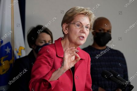 Sen. Elizabeth Warren, D-Mass., center, responds to questions from reporters as Mass. Attorney General Maura Healey, left, and U.S. Rep. Ayanna Pressley, D-Mass., right, look on during a news conference, in Boston. The news conference was held to call on President Biden to use the Higher Education Act to cancel a share of student loan debt for students with federal loans