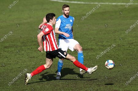 (CAPTION CORRECTION) Mark Beevers of Peterborough United    passes under pressure from Ross  Stewart of Sunderland