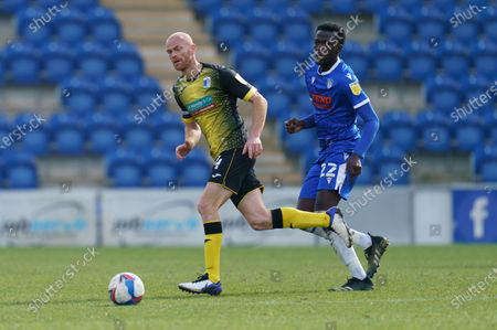 Jason Taylor of Barrow A.F.C. (4) and Brendan Sarpong-Wiredu of Colchester United (22)
